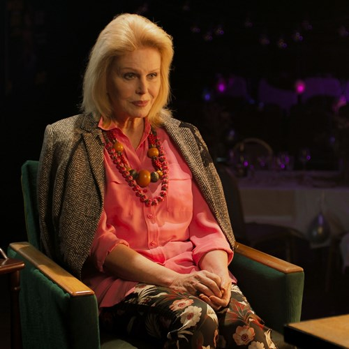 A photograph of actress Joanna Lumley dressed smartly, performing in The Picture of Dorian Gray